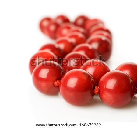 Coral beads isolated on white - stock photo