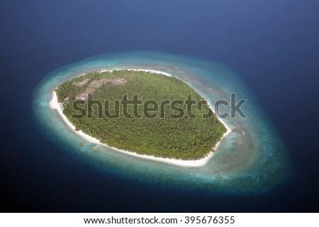 coral island in the Indian Ocean - stock photo