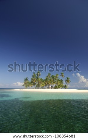 Coral reef and small island with palm trees forest. Kuna Yala, San Blas Achipelago, Panama, Caribbean, Central America. - stock photo