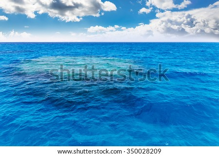Coral reef under water. The view from ship.