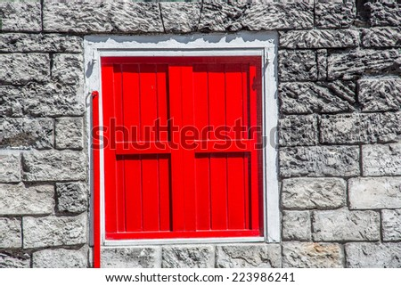 coral stone houses with red shutter in Caribbean  - stock photo