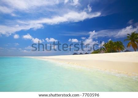Coral tropical beach on the island Kuredu in the Indian Ocean, Maldives - stock photo