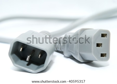 Cord of power supplies for the computer on a white background