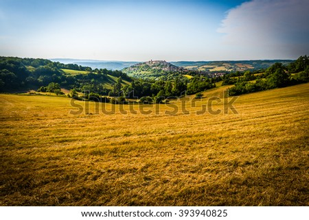 Cordes-sur-Ciel, a village near Albi in Tarn, Midi-Pyrenees, Southern France, as seen from the southern viewpoint. - stock photo