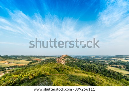 Cordes-sur-Ciel, a village near Albi in Tarn, Midi-Pyrenees, Southern France, as seen from the eastern viewpoint. - stock photo