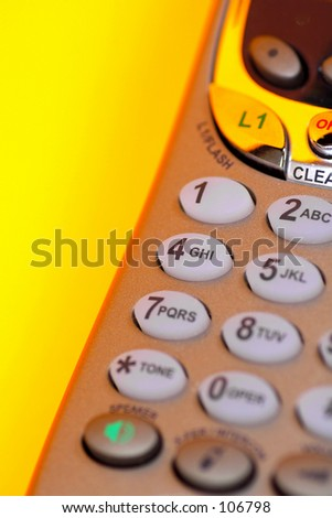 Cordless Telephone on Orange Background