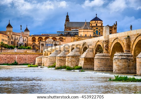 Cordoba, Spain, Andalusia. Roman Bridge on Guadalquivir river and The Great Mosque (Mezquita Cathedral). - stock photo