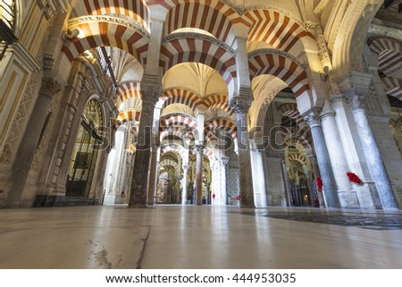 CORDOBA - SPAIN - JUNE 10, 2016 :Arches Pillars Mezquita Cordoba Spain. Created in 785 as a Mosque, was converted to a Cathedral in the 1500. 850 Columns and Arches