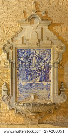 CORDOBA, SPAIN - MAY 27, 2015: The baroque fountain with the ceramic image Virgin Mary among the saints on the facade of church of St. Francis and Eulogius. - stock photo