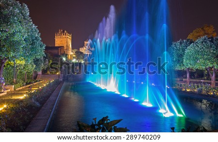 CORDOBA, SPAIN - MAY 25, 2015: The fountains show in the gardens of Alcazar de los Reyes Cristianos castle at night. - stock photo