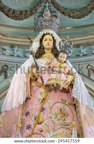 CORDOBA, SPAIN - MAY 26, 2015: The traditional vested statue of Madonna in Church Eremita de Nuestra Senora del Socorro on main altar designed by Alfons Gomes Caballero from 17. cent. - stock photo
