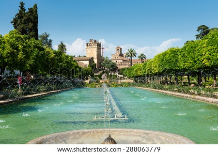 CORDOBA, SPAIN - MAY 19: Wide-angle view of a fountain in the gardens of the Alcazar de los Reyes Cristianos (Alcazar of the Christian Monarchs) in Cordoba, on May 19, 2015. - stock photo