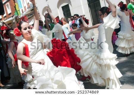 CORDOBA, SPAIN - MAY 3: Women performing a sevillana dance in the street, in San Nicolas square, celebrating Cordoba´s Cruxes, on may 3, 2014, in Cordoba, Spain - stock photo