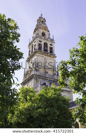 CORDOBA, SPAIN - October 25, 2014: The Bell Tower, also called the Tower of Alminar, seen from the Courtyard of the Orange Trees of the Mosque-Cathedral on October 25, 2014 in Cordoba, Spain