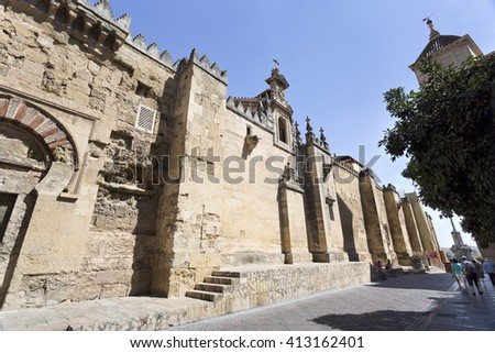 CORDOBA, SPAIN - September 10, 2015: Tourists walking along the west facade of the Mosqu -Cathedral of Cordoba, on September 10, 2015 in Cordoba, Spain - stock photo