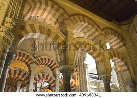 CORDOBA, SPAIN - September 10, 2015: View of the many columns and arches of the Great Mosque of Cordoba, on September 10, 2015 in Cordoba, Spain - stock photo