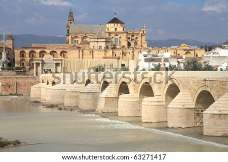 Cordoba, Spain. The Great Mosque (currently Catholic cathedral). UNESCO World Heritage Site. View with famous Roman Bridge and Guadalquivir river. - stock photo