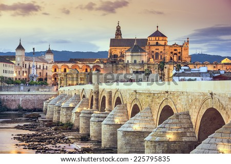 Cordoba, Spain view of the Roman Bridge and Mosque-Cathedral on the Guadalquivir River. - stock photo