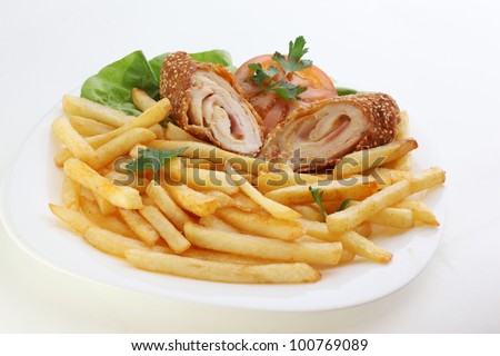 Cordon bleu and french fries served on white plate