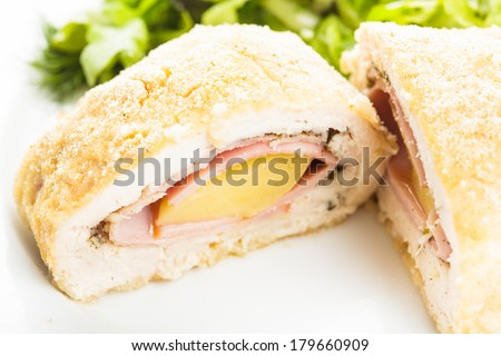 Cordon bleu - chicken cutlet stuffed with ham and cheese - stock photo