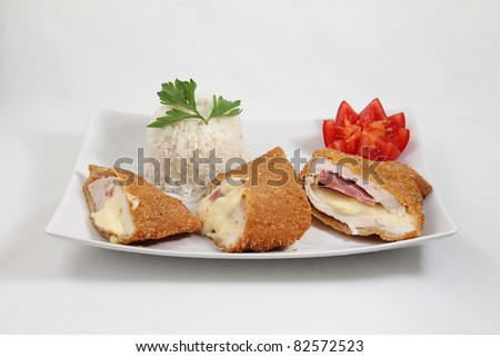 cordon bleu with rice on white plate isolated on white background - stock photo