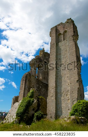 Corfe Castle, Dorset, England - July 14, 2016 - The ruins of Corfe Castle on the hill above the village.