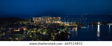Corfu, Greece, April 22, 2017. Panoramic view of Kommeno bay and Corfu Imperial hotel. View from Eva Palace.