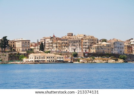 CORFU, GREECE - JUNE 23, 2014: Looking towards the buildings of Corfu Town from Kerkira harbour on the Greek island of Corfu. At 40 miles long, Corfu is the second largest of the Ionian islands. - stock photo