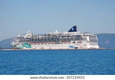 CORFU, GREECE - JUNE 23, 2014: Passenger cruise ship Norwegian Jade moored in Kerkira harbour on the Greek island of Corfu. The 294mtr ship was built in Germany in 2006. - stock photo