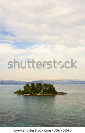 Corfu, greece, Mouse Island Pontikonisi with the mountains of Albania in background