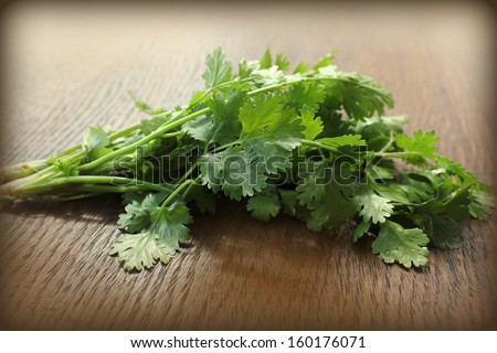 Coriander on a wooden table