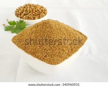 Coriander powder in a bowl. - stock photo