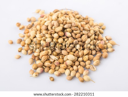 Coriander seed over white background