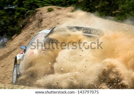 CORINTHIA, GREECE - JUN 1: Spanish driver Daniel Sordo and his codriver Carlos del Barrio in a Citroen DS3 WRC race in the 59th Acropolis Rally of Greece, on Jun 1, 2013 in Loutraki, Greece. - stock photo