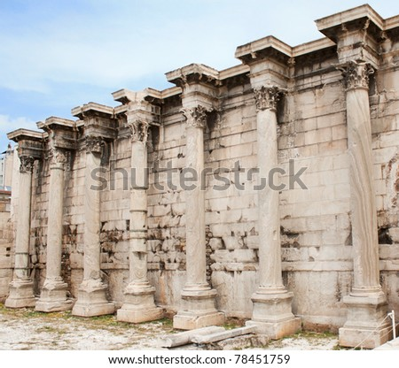 Corinthian columns of the ruins of the Hadrian's Library in the Roman Forum of Athens, Greece. - stock photo