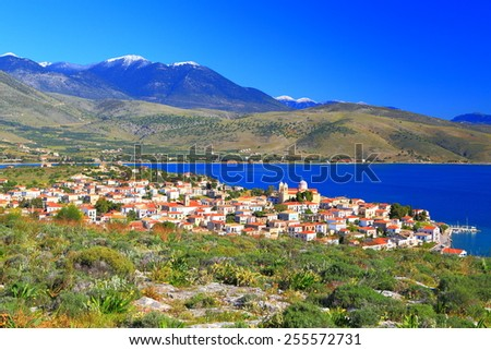 Corinthian gulf and traditional Greek harbor and town surrounded by green hills and mountains, Greece - stock photo