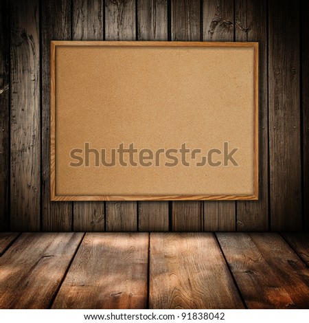 Cork board at wooden panel wall interior background - stock photo