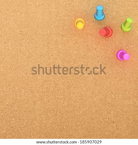 Cork board fragment with five colorful pins put in the corner - stock photo