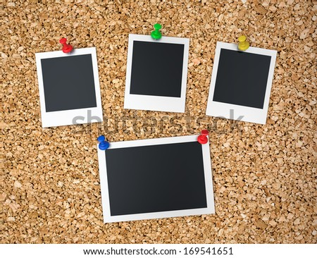 Cork board with blank instant photo prints  - stock photo