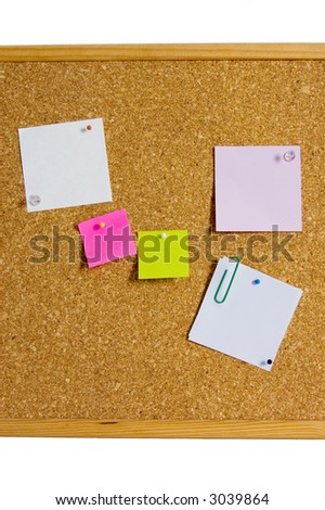 Cork board with blank papers