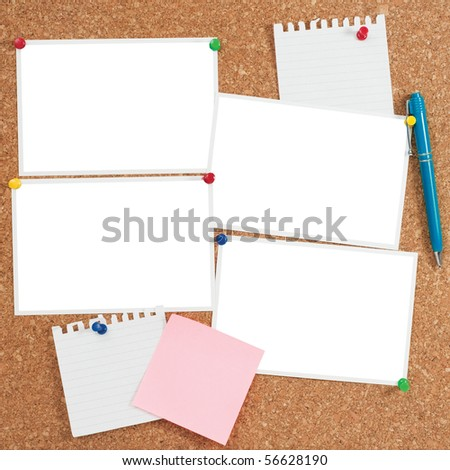 Cork board with blank photo prints and notes - stock photo