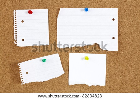 Cork board with blank white paper
