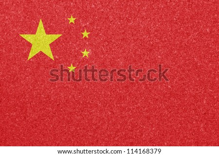 Cork board with the flag of China painted on it - stock photo