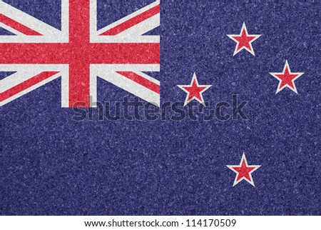 Cork board with the flag of New Zealand painted on it - stock photo