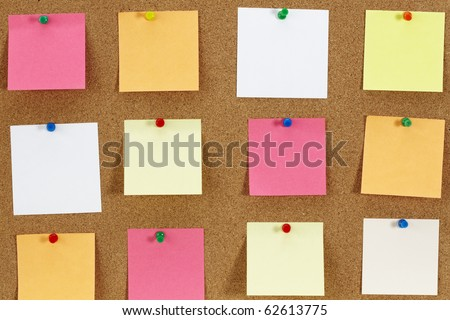 Cork board with various note papers - stock photo