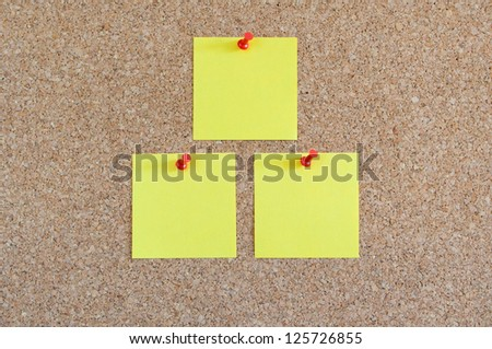 Cork board with yellow post-it - stock photo
