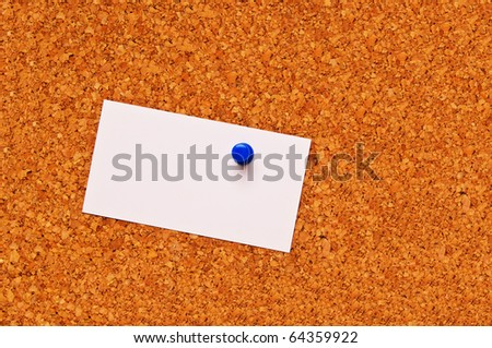 cork bulletin board with blank business card