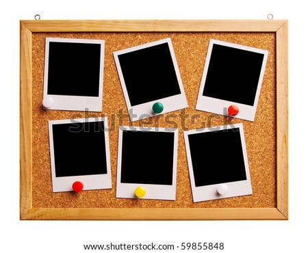Cork bulletin board with instant photo cards. - stock photo