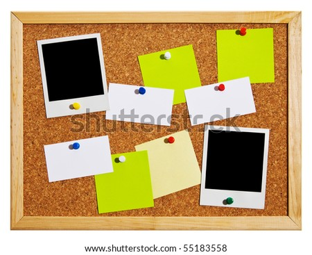 Cork bulletin board with notes, business cards and instant photo cards. - stock photo