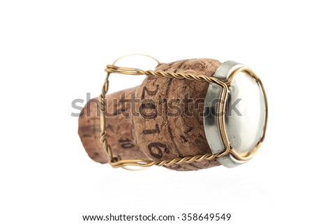 Cork from champagne bottle, isolated on the white background. Concept object for a celebration event or new yearâ??s eve 2016. - stock photo